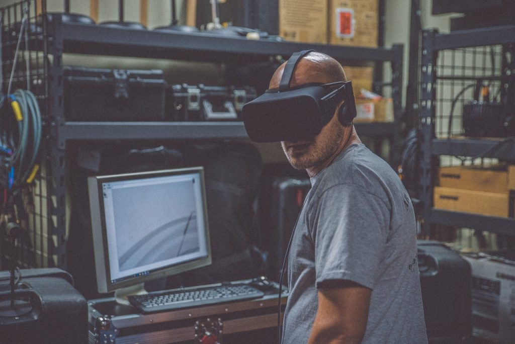 A man probably doing some sort of VR soft skills training or some other VR training