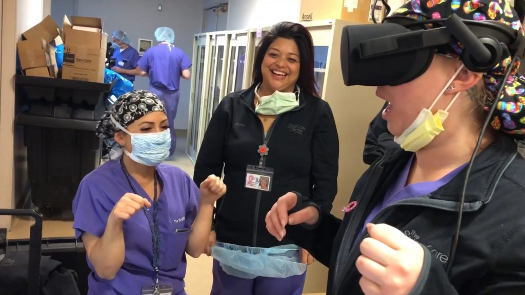 Medical professionals looking super excited and pleasantly surprised while during and after Elara's VR experience of ocular nerve
