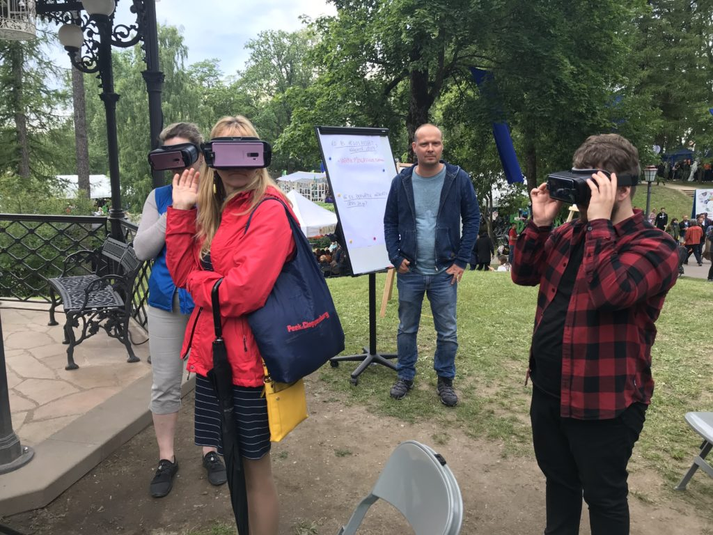 People using VR headsets to visualise how the city would potentially look like due to improved urban planning