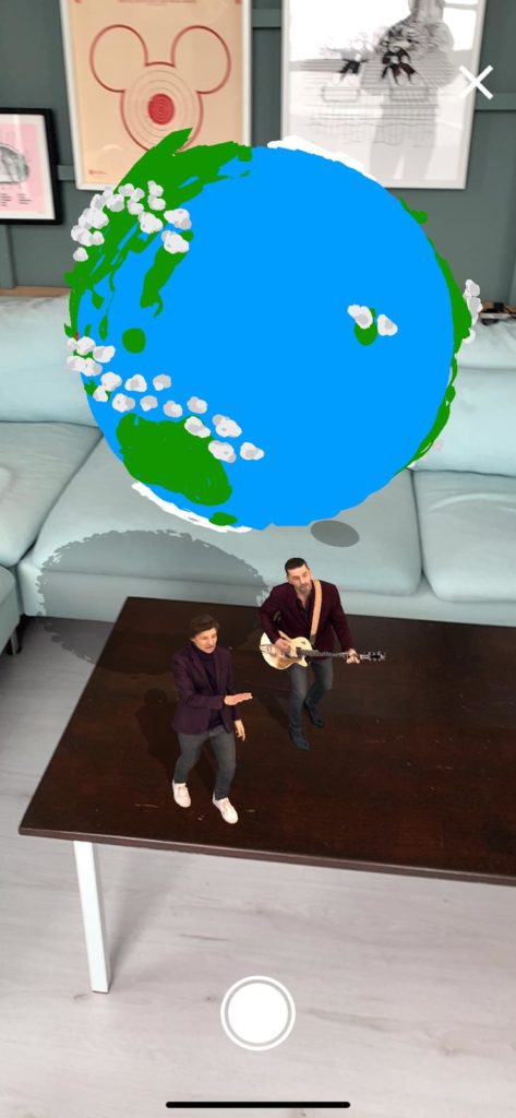 Clouseau performing their music video in augmented reality