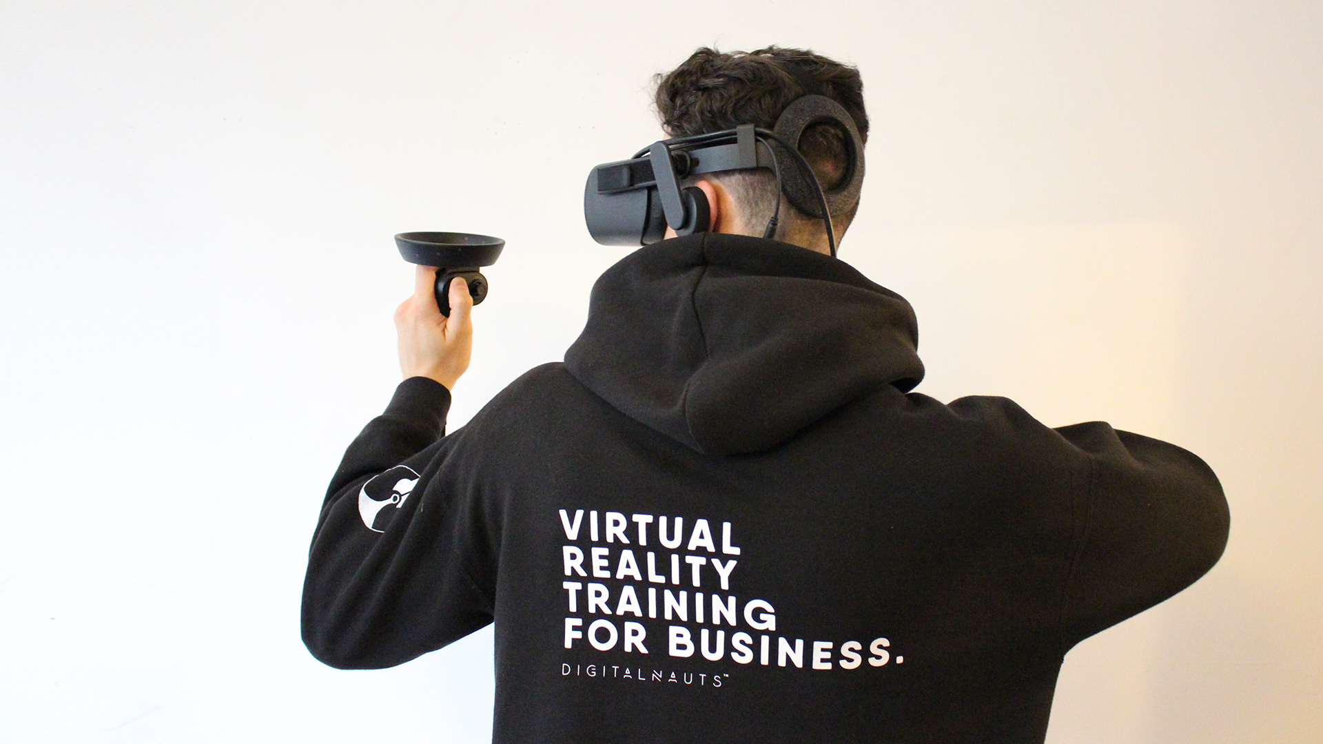 Man wearing Digitalnauts hoodie illustrating how work could be done due to VR adoption