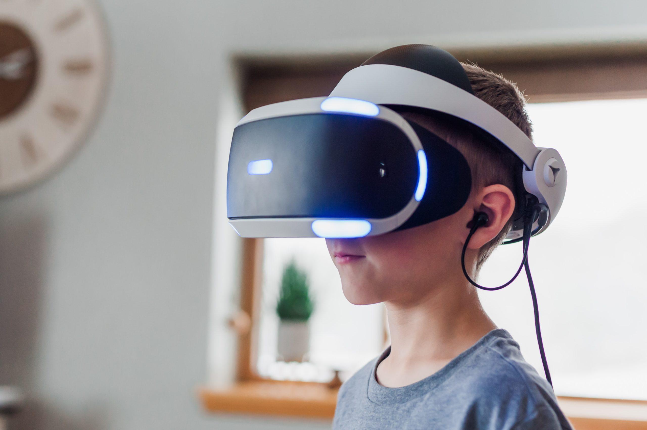 A boy wearing VR headset