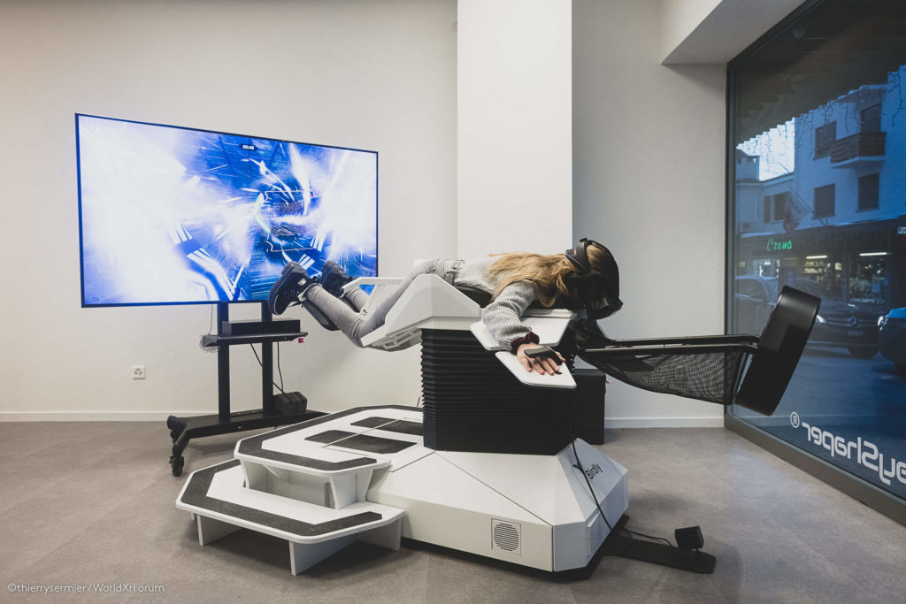 Women experiencing a virtual flight experience while using Birdly hardware solution
